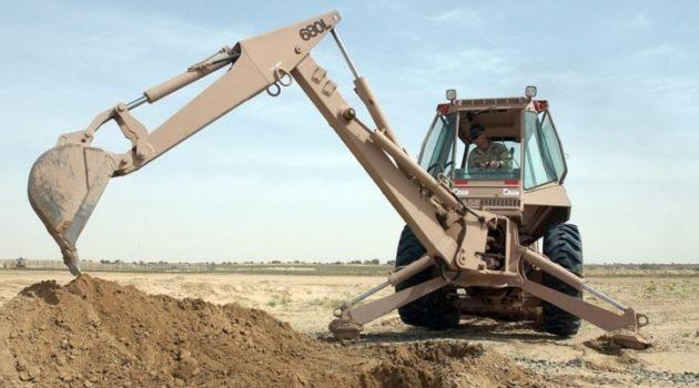 transporting backhoe construction