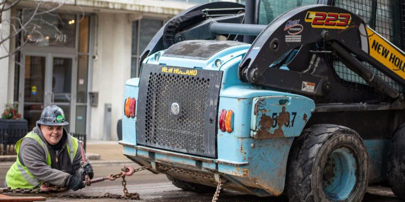worker unloading skid steer chicago digital transformation